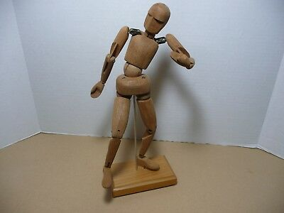 Wooden moveable hinged sculpture of human with pedestal