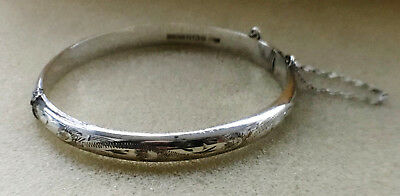 Solid silver bangle with an engraved front 1979
