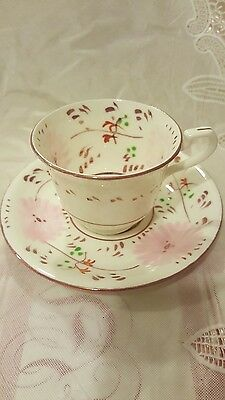 ALLERTONS  pink lustre decorated teacup and saucer