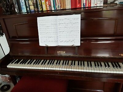 Acoustic upright piano, manufactured by Steck