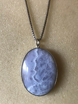 Solid silver blue stone pendant and a chain