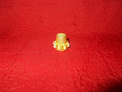 brass tone thimble with pearl band