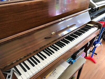 Upright overstrung piano with stool. good overall condition but needs tuning.