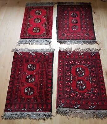 4 slightly different red Afghan rugs, approx 40cm x 60cm, handmade, wool