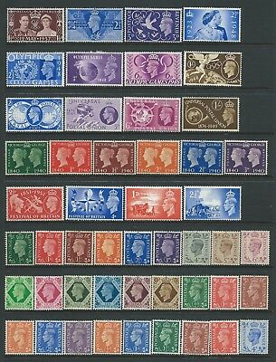 Collection of mounted MINT GVI GB stamps, several sets.