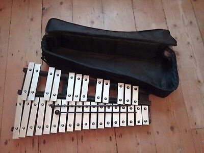 Black wooden glockenspiel with beaters