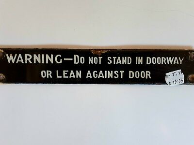 SAR WARNING - DO NO STAND IN DOORWAY sign