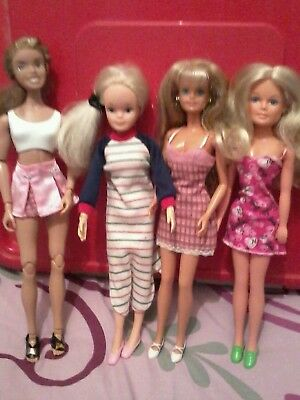 4 dolls inc sindy with clothes