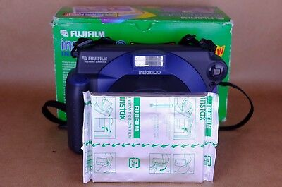 Fujifilm Instax 100 instant camera with sealed film pack. Great condition.