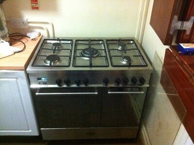 Delonghi 5 ring range Cooker.  Gas rings and 2 electric ovens