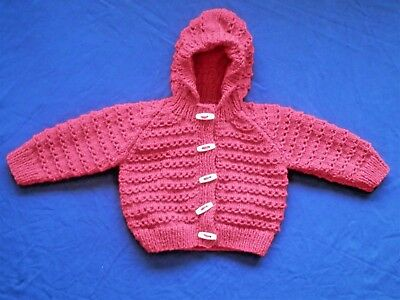Hand Knitted Baby Cardigan with hood in white variegated. 3-6 Months.