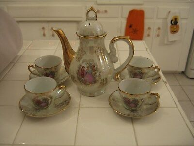 Beautiful Vintage Tea Set With 4 Cups And Saucers With Victorian Courting Couple