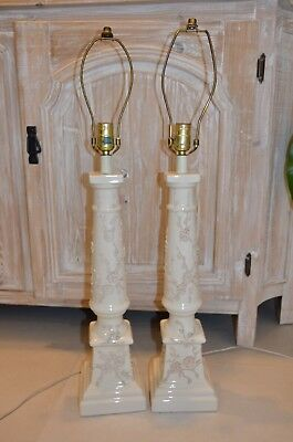 a pair of antique floral lamp bases cream color