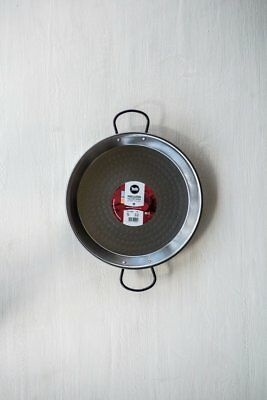 Paella pan made of polished carbon steel