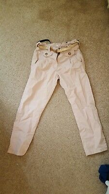 Girls cream trousers with gold belt  age 7 by NEXT