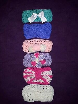 hand knitted babies headband.