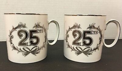 2 (TWO) 25th ANNIVERSARY HANDLE CUPS NORCREST FINE CHINA WHITE & SILVER MUGS