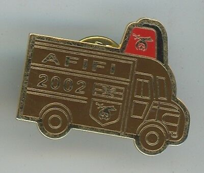 Hat or Lapel Pin - Shriners AFIFI 2002 Brown / Gold  Bus with Red Fez D-3
