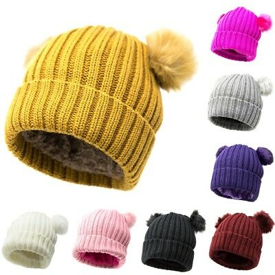 dbbc0cafde1 New Women s Beanie Double Pom Hat Trendy Thick Winter Solid Cable Knit Hat