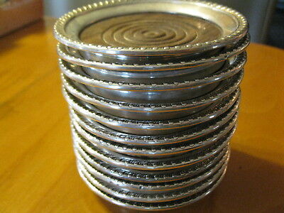 12 Mueck-Carey Co. sterling silver and wood coasters 1940-50s.