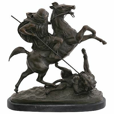 Predator on horse with spear hunting a Lion as bronze sculpture