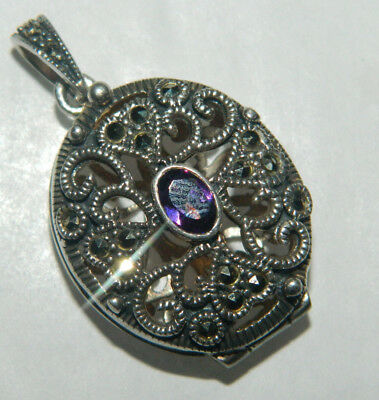 A vintage style sterling silver marcasite & amethyst locket pendant