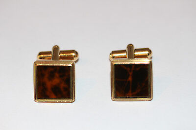 A pair of Dunhill gold plated and enamel cufflinks