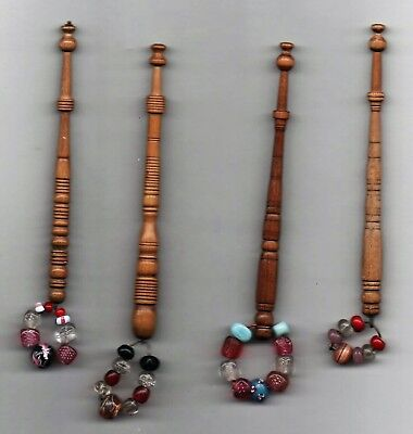 Four Turned Antique Lace Bobbins In Light Coloured Wood