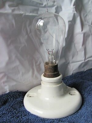 Antique vintage creamic light socket & bulb tipped & clear glass with 2 filament
