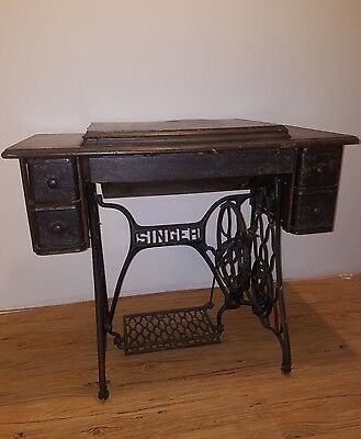 Antique red eye singer treadle sewing machine, 5 drawer cabinet, and extras!!