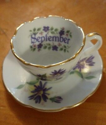 Golden crown demi tea cup and saucer September germany