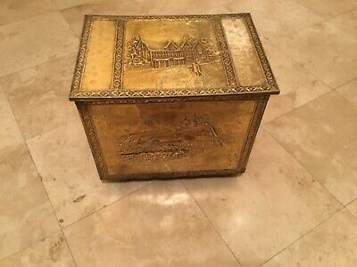 Vintage brass kindling chest box on casters embossed repousse fireplace decor
