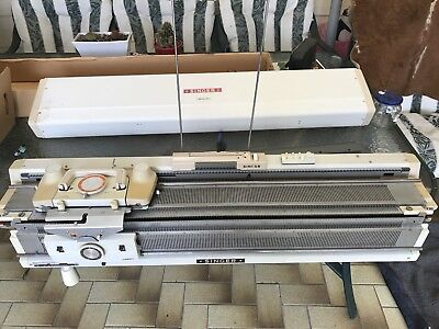 Singer 323 Memo-matic Knitting Machine with accessories.
