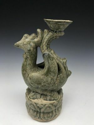 The ancient ceramic sculpture of the phoenix back in pot