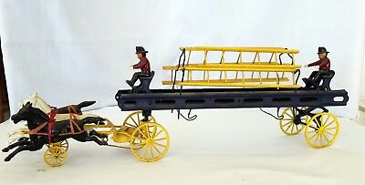 Vintage Cast iron horse drawn fire wagon w/wooden ladders