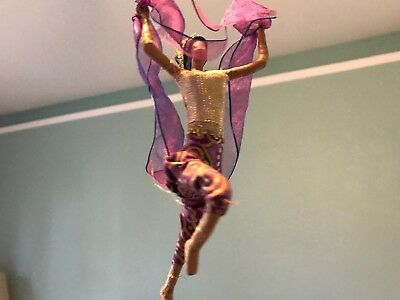 Sarena Mann flying lady with pink ribbon