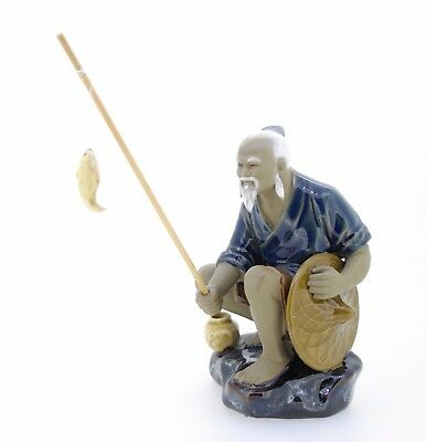 """Figurine Chinese ceramic Fisherman 5 1/4 inches with pole with fish 1"""" on string"""