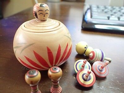 Traditional ejiko kokeshi with koma spinner and small kokeshi inside. (sn03)