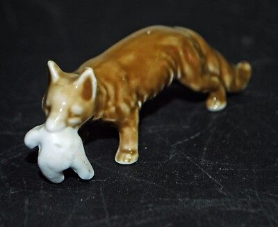 Vintage Realistic Ceramic Fox Figurine Carrying a Chicken or a Dove in its Mouth