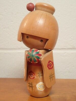 6 inch tall lovely cute girl kokeshi holding a ball with a long sleeve (ch01)