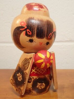 Lovely girl sosaku kokeshi holding ball, carved and painted signed Chieko (ch02)
