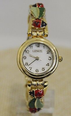 Lenox Women's Gold Tone Watch With Lady Bug Band And Mother Of Pearl Dial