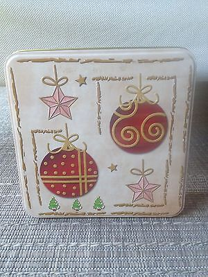 Off-white colour biscuit/cookie tin with Christmas decorations circa 2000