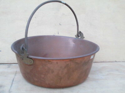 Large copper pot with bucket style handle.