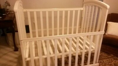 White baby cot and matching change table