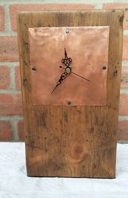 Handmade antique wood clock with copper face