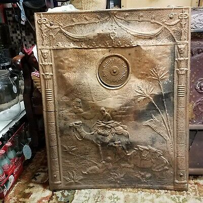 Antique 19th C front Fireplace cover of a man riding a camel, very ornate Tin