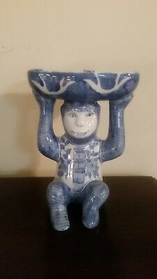 Blue and white monkey with bowl