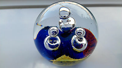 A Pretty Colourful Paperweight With Bubbles Rising From The Base