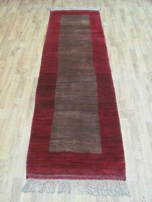 A NICE OLD HANDMADE GABBEH PERSIAN WOOL ON WOOL RUG (234 x 69 cm)